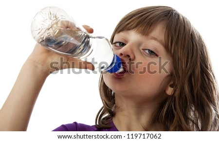 a little girl drinking water - stock photo