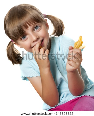 a little girl eating french fries - stock photo