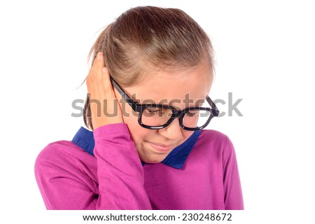 a little girl has earache on white background - stock photo