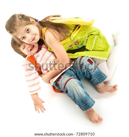 A little girl helps her crying sister - stock photo