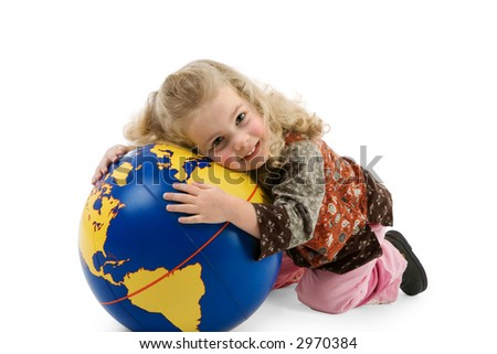 a little girl holds a globe in her hands - stock photo