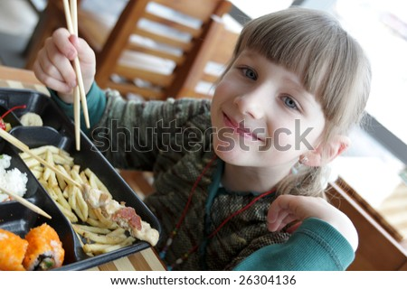 A little girl in a japanese restaurant - stock photo