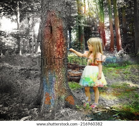 A little girl is painting trees with colors in a black and white forest for an creativity or imagination concept about art. - stock photo