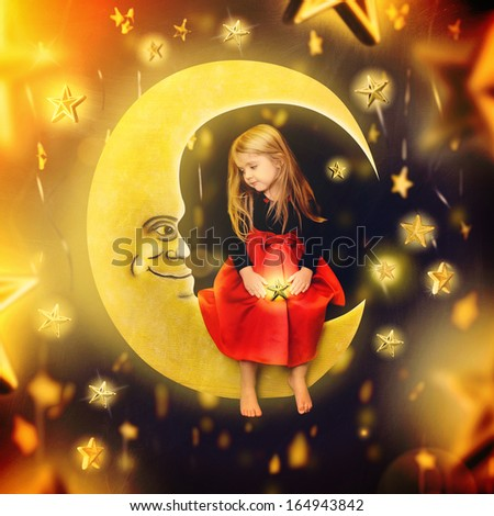 A little girl is sitting on an art drawing of a bright yellow moon with falling stars in the background. The child is making a wish for an imagination or bedtime concept. - stock photo