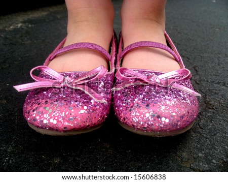 little girl is wearing pink, sparkly tap shoes. Horizontally framed