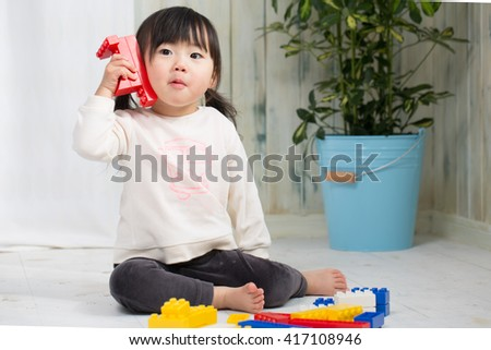 a little girl playing - stock photo