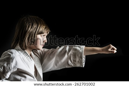 a little girl practicing karate - stock photo