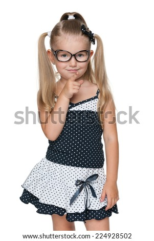 A little girl shows her finger forward against the white background - stock photo