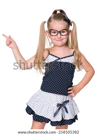 A little girl shows her finger to the side on the white background - stock photo