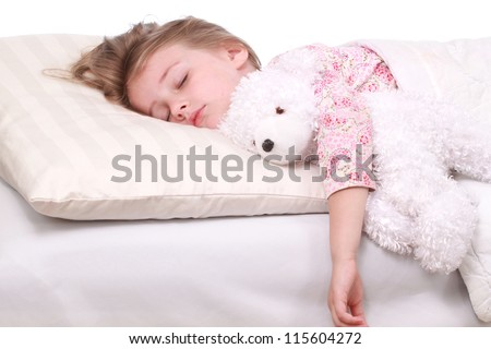 A little girl sleeping on a large white pillow - stock photo