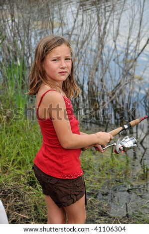 a little girl spends some time fishing - stock photo