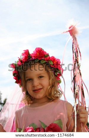 A little girl with a wand dressed up like a fairytale princess. - stock photo