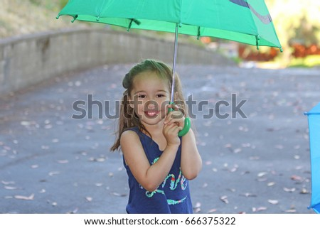 A little girl with an umbrella, summer time, sunny weather