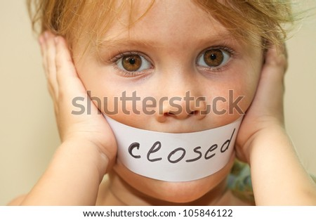 """a little girl with the words """"closed"""" - stock photo"""