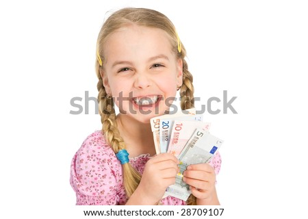 a little happy girl with money - stock photo