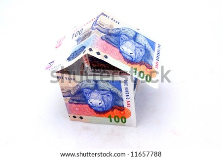 A little house made from three one hundred South African Rand bills isolated on white background