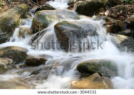 A little river falling between rocks in the mountains