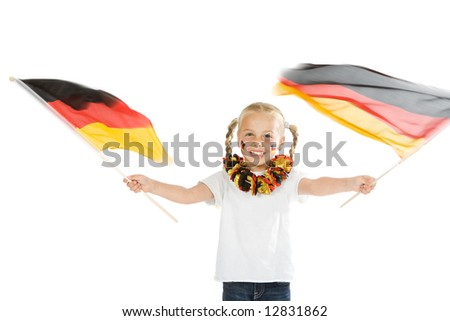 a little soccer fan with two flags