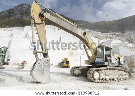 A loader in marble quarry - stock photo