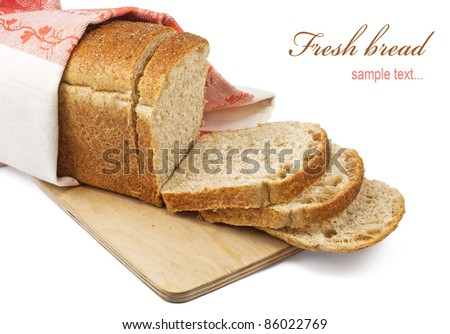 A loaf of fresh bread isolated on white - stock photo