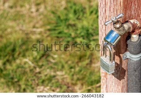 A locked Spigot in a California Park due to the water drought - stock photo