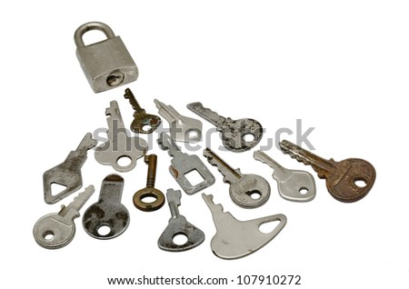 A Locked with many wrong Keys. over white background - stock photo