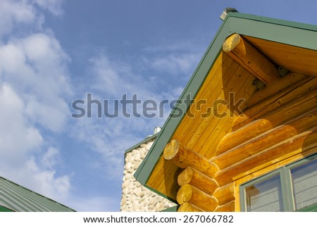 A log cabin home in a rural environment - stock photo