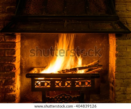 A log fire in a chimney - stock photo