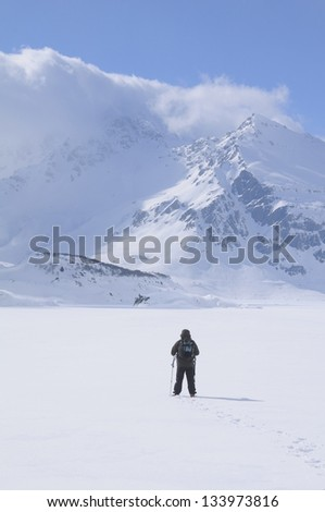 A lone hiker in the cold landscape of Mont Cenis ( France ). - stock photo