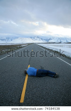 a lone man dies of dehydration in the hot dry desert of Death Valley just inches away from a bottle of water - stock photo