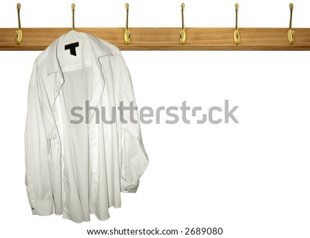 a lone shirt hanging on a coat rack - stock photo