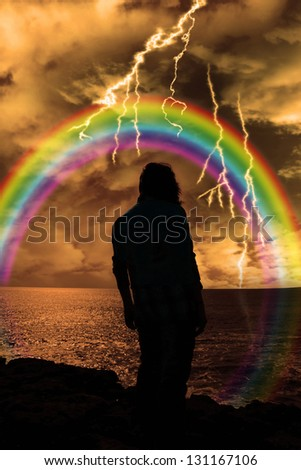a lone woman looking over the cliffs edge thinking life is to much and sees hope in the Rainbow