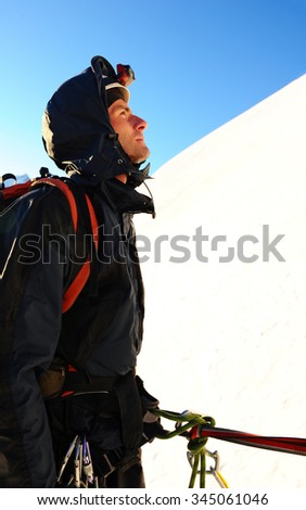 A lonely climber reaching the summit, Nepal Himalayas - stock photo