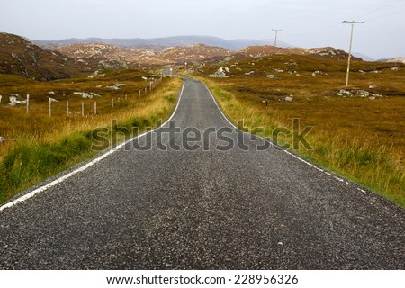 A lonely road in the scottish highlands - stock photo
