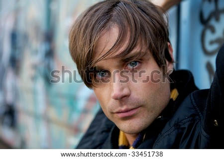 A lonely street kit sitting by a wall - stock photo