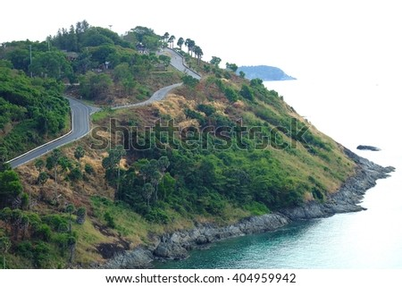 A long and crooked road head to Phromthep Cape, Phuket, Thailand. - stock photo