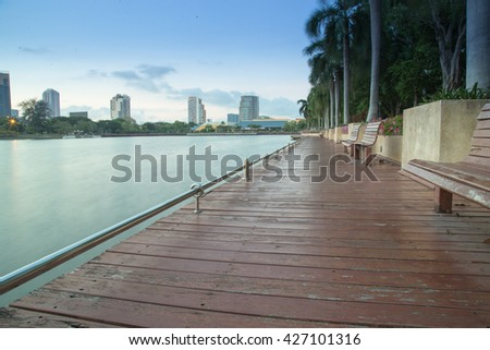 A long calm wood walkway in a park of Bangkok in Thailand