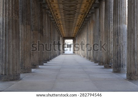 A long corridor between many columns in a historical building in berlin - stock photo