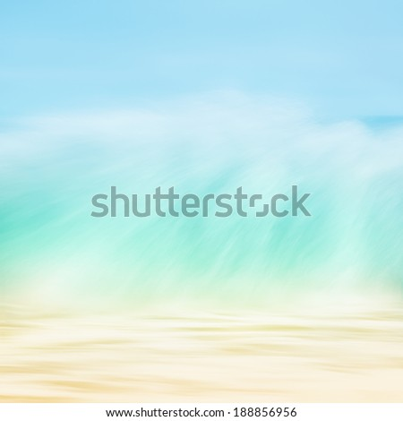 A long exposure abstraction of an ocean wave breaking on shore.  Image done with soft, pastel colors. - stock photo