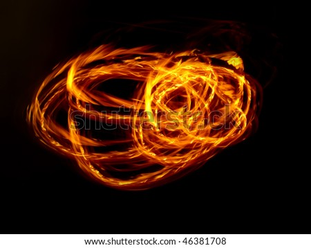 A long exposure fire-ball isolated on black - stock photo
