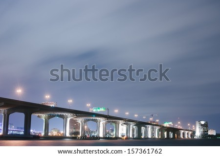 A long exposure of a bridge over the St. Johns River in Jacksonville, Florida. - stock photo