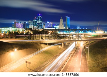 A long exposure of an elevated view of Kansas City, Missouri skyline at night. - stock photo