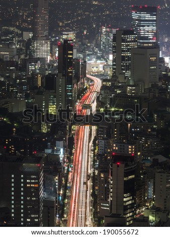 A long exposure photo of an important road in the heart of Tokyo (Shibuya), the capital city of Japan - stock photo
