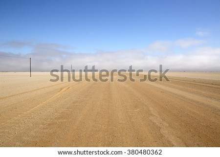 A long open road typical of Namibia. - stock photo