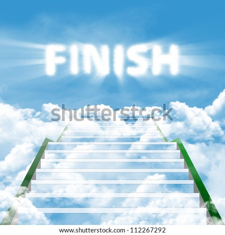A long stairway leading upward in clouds on a background blue sky with text of FINISH - stock photo
