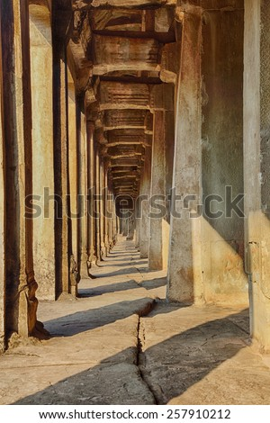 A long stone walkway that is part of the temple complex of Angkor Wat near Siem Reap, Cambodia - stock photo