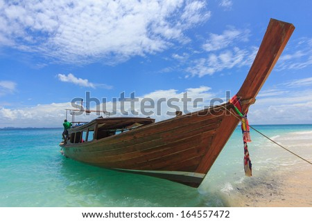 A long tail boat on a beach in Krabi, Thailand