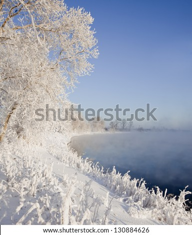 a long walk along the river in winter - stock photo