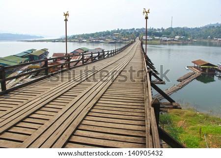 A long wooden bridge at Sangkha. Kan Buri province on Thailand. - stock photo
