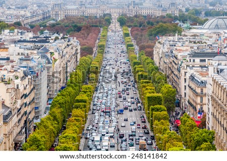 A look down the  Champs-��lys�©es as seen from the Arc de Triomphe. - stock photo